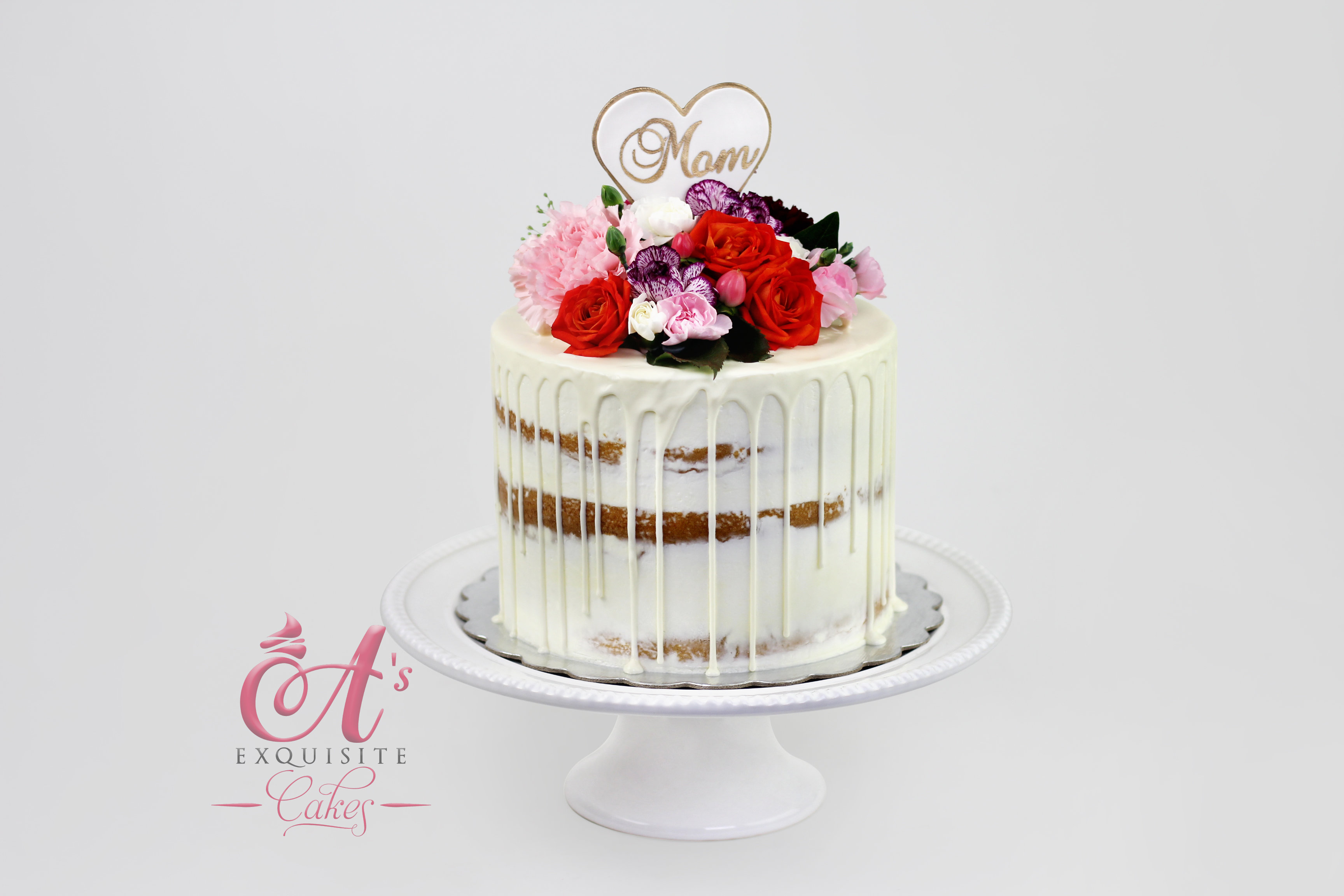 Semi Naked Drip Cake With Fresh Flowers Serves 15
